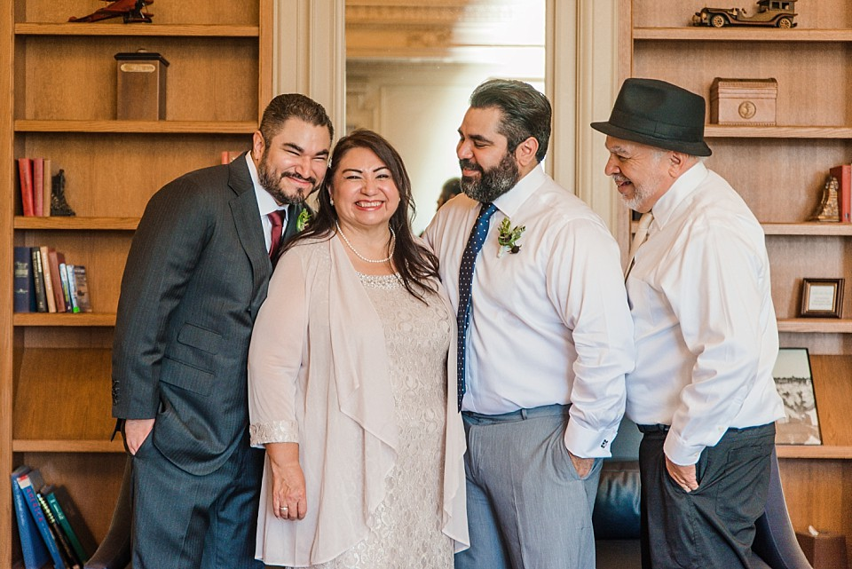 groom and family surrounded by mother wedding