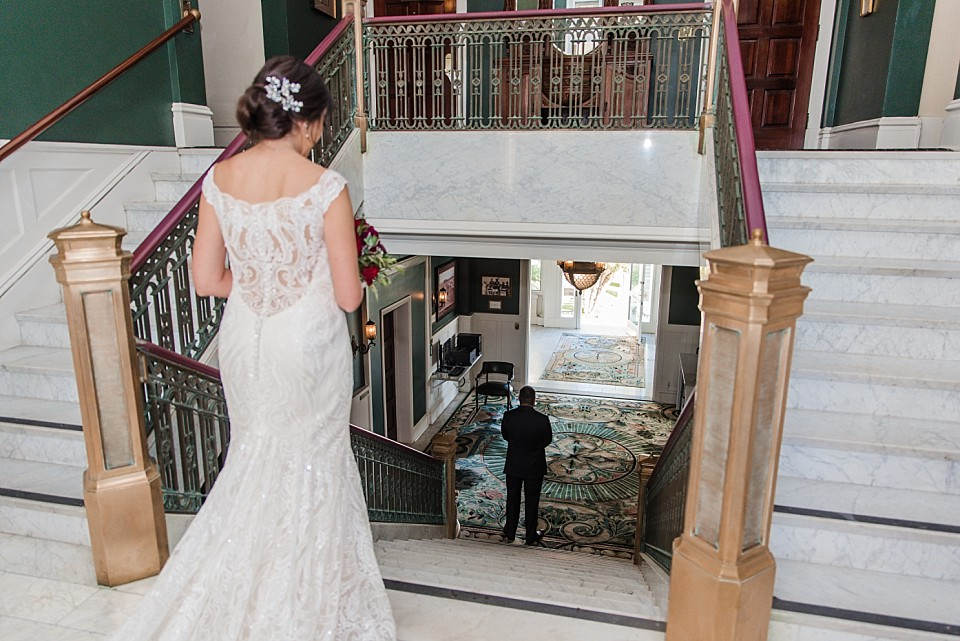 bride walking down staircase first look Glorietta Bay Inn Coronado