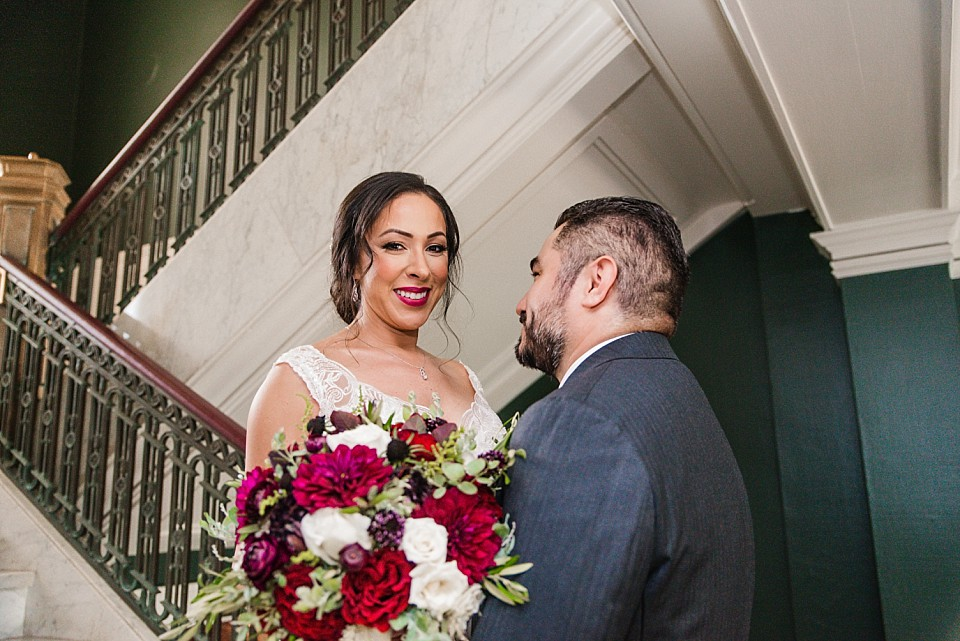 bride smiling on staircase during first look moment Coronado wedding