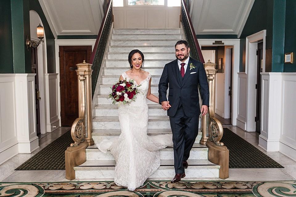 bride groom walking down Glorietta Bay Inn staircase Coronado wedding photographer
