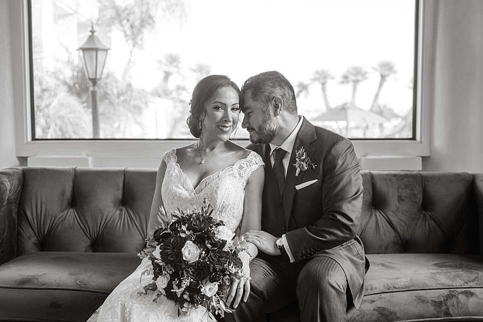 black white couple wedding portrait sitting couch Coronado
