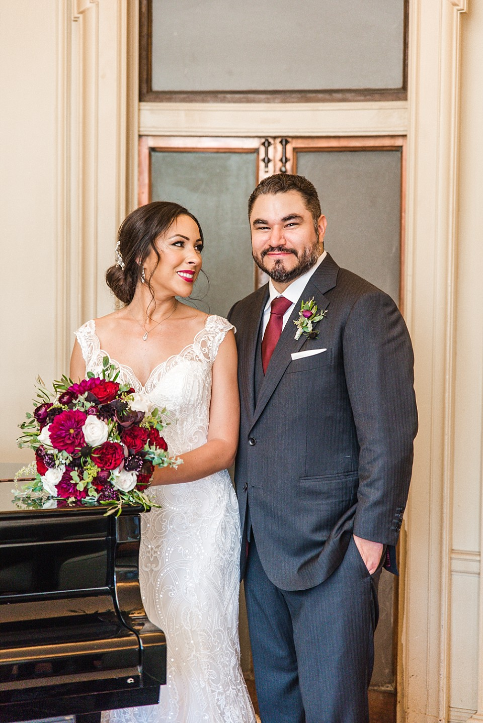 portrait bride admiring groom piano parlor room Coronado wedding photographer