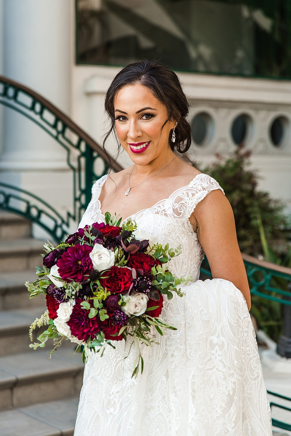 stunning bride standing at hotel entrance Glorietta Bay Inn Coronado wedding
