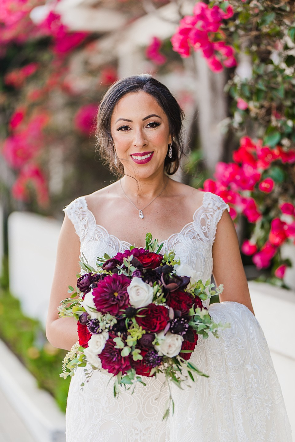 portrait gorgeous bride standing near fuchsia bougainvillea Glorietta Bay Inn Coronado