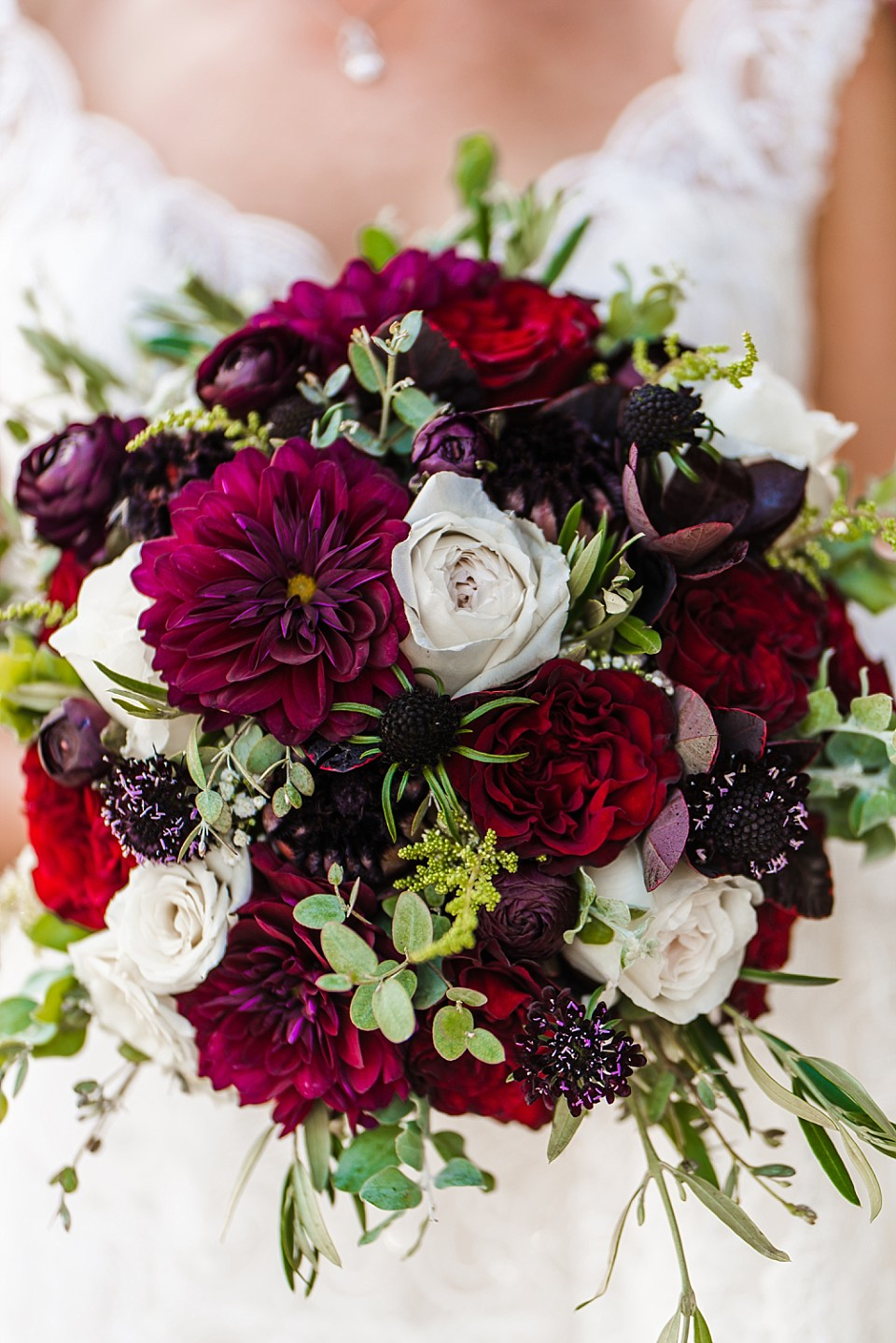 vibrant red white bridal bouquet up close