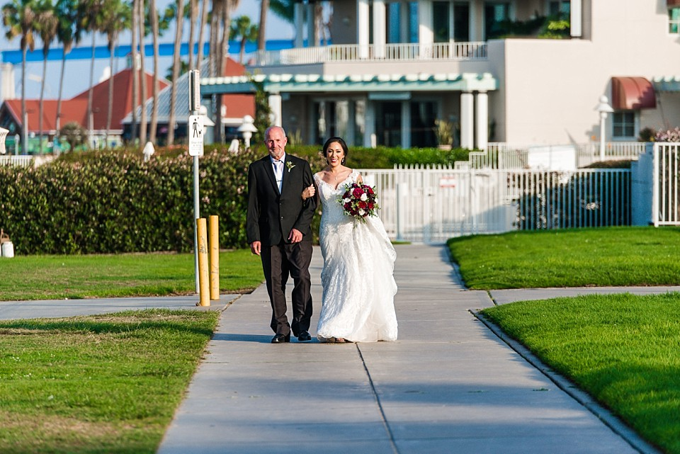 bride dad walking down sidewalk outdoor intimate wedding Coronado
