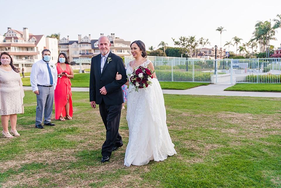 bride approaching groom outdoor pandemic wedding San Diego