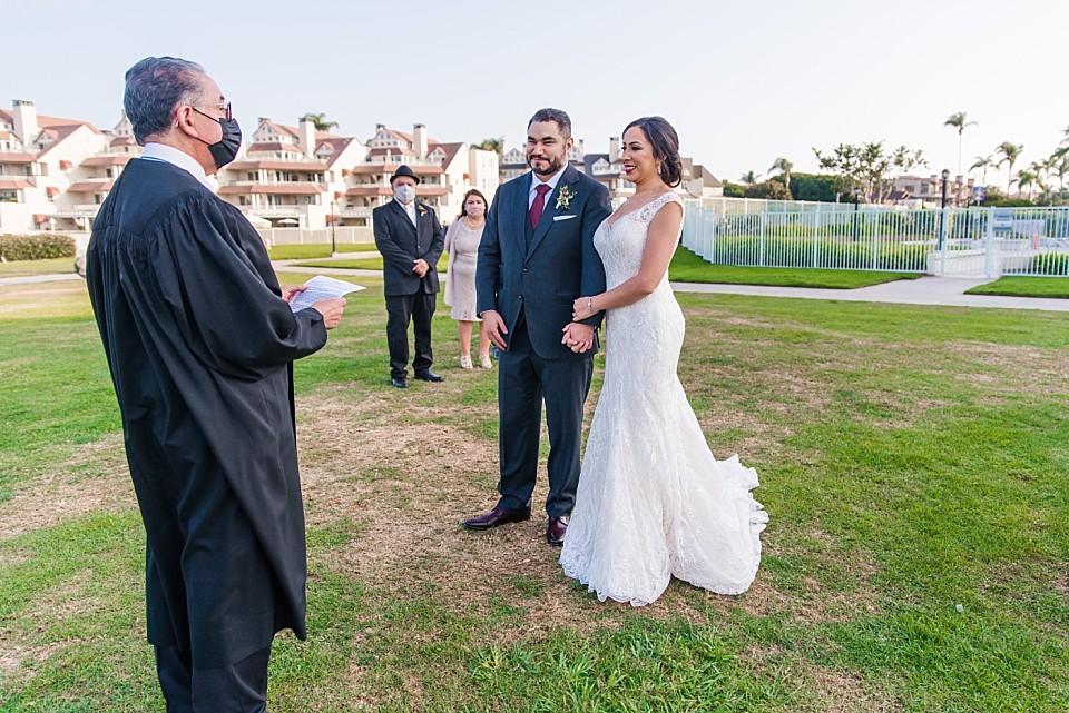 bride groom standing together micro wedding ceremony