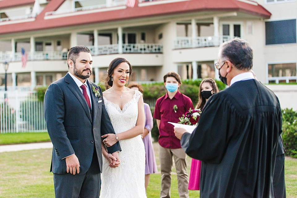 officiant speaking to bride groom small wedding ideas