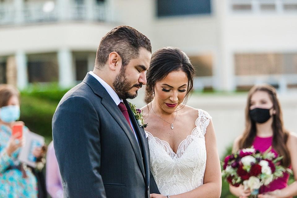 moment of prayer during outdoor wedding Coronado