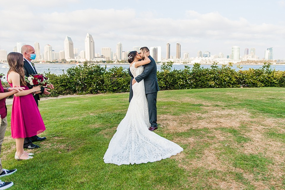 bride groom share a first kiss pandemic wedding planning