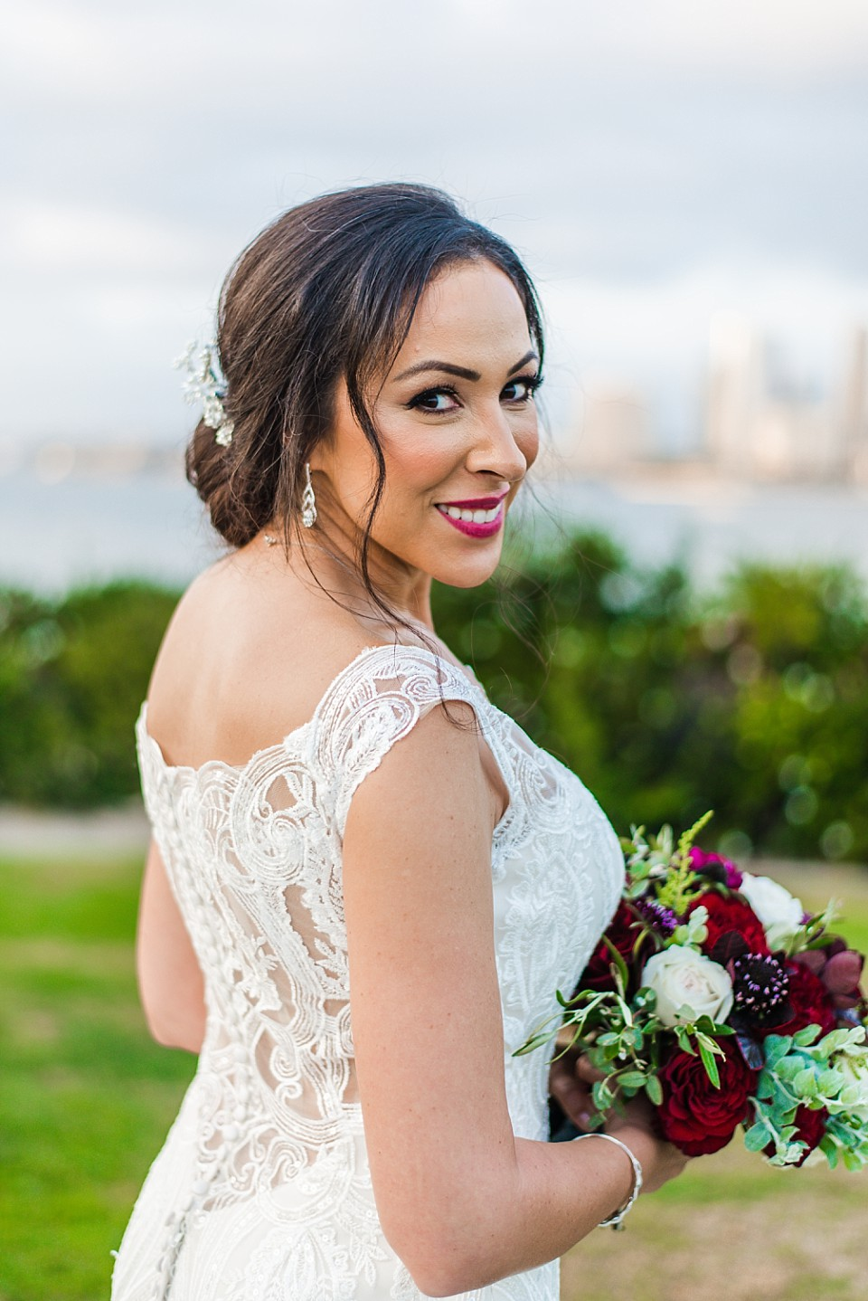 smiling stunning bride portait red white bouquet Coronado wedding photographer