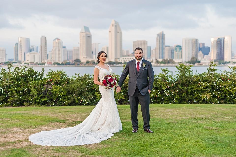 bride groom posing San Diego skyline Centennial Park Coronado wedding