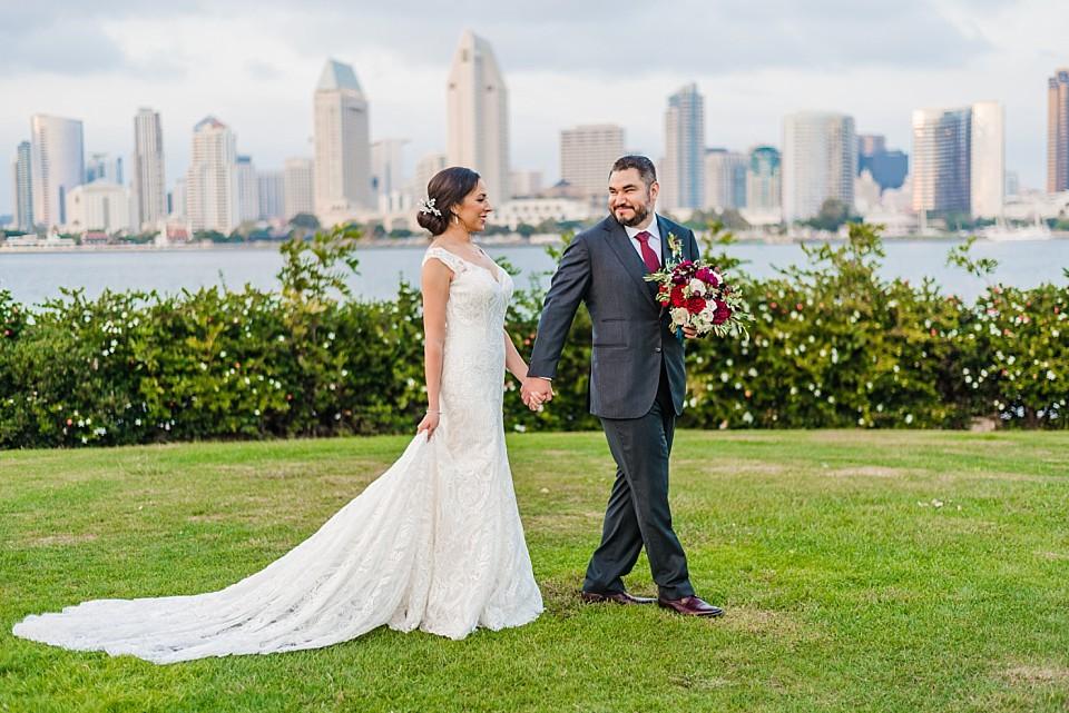 Centennial Park Coronado wedding groom leading bride grassy area