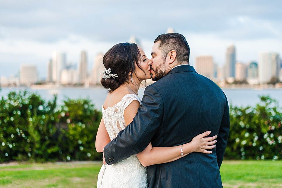 couple kissing in front of San Diego Skyline Coronado wedding photographer