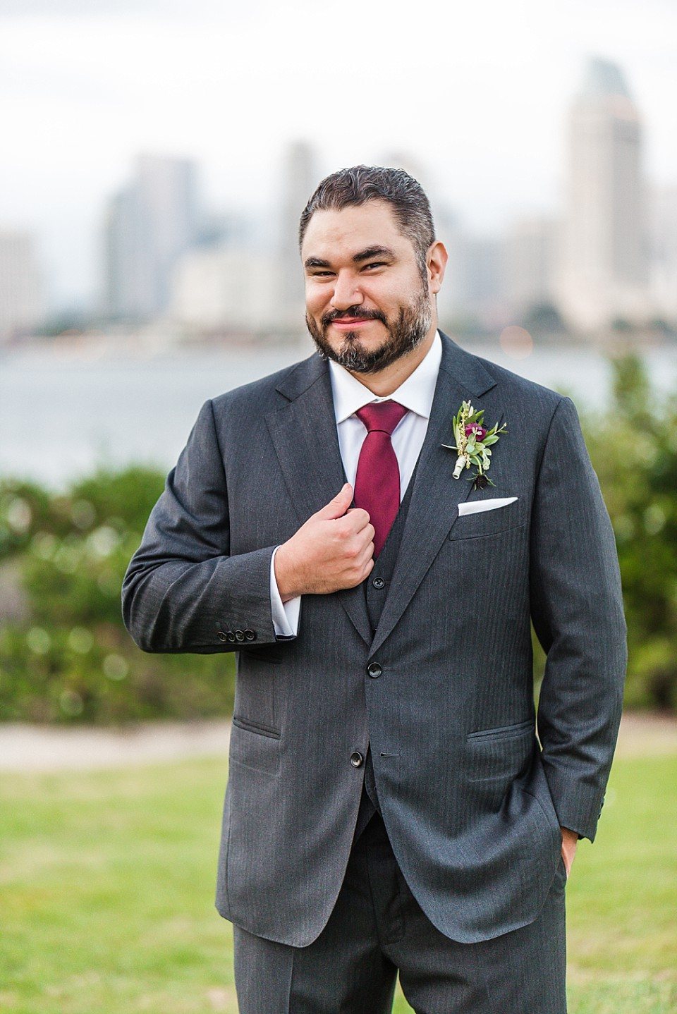 portrait of groom holding lapel San Diego photographer