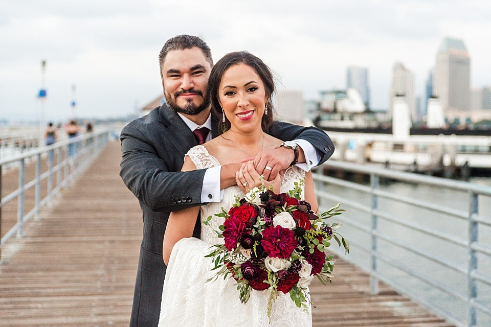 bride groom posing on pier at Ferry Landing Coronado California