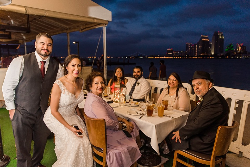 couples celebrates intimate wedding family Coronado restaurant Il Fornaio