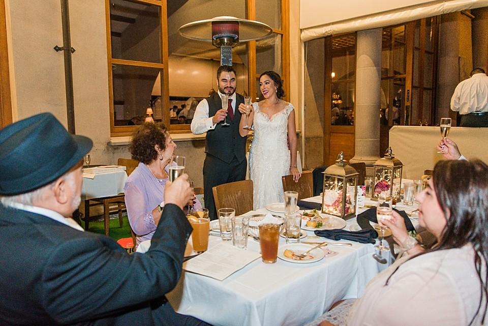 bride groom sharing toast Il Fornaio restaurant Coronado