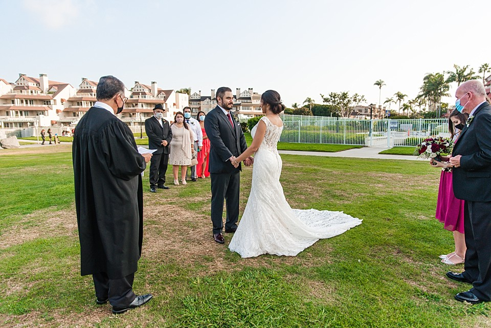 couple holding hands outdoor small wedding ideas
