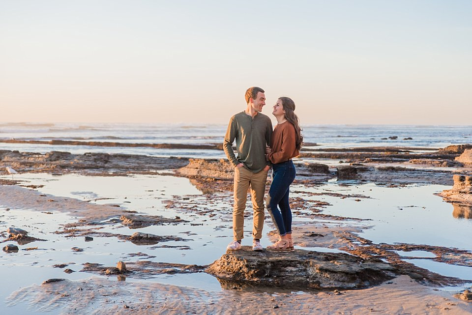 couple embracing smiling at each other san diego engagement photos romantic