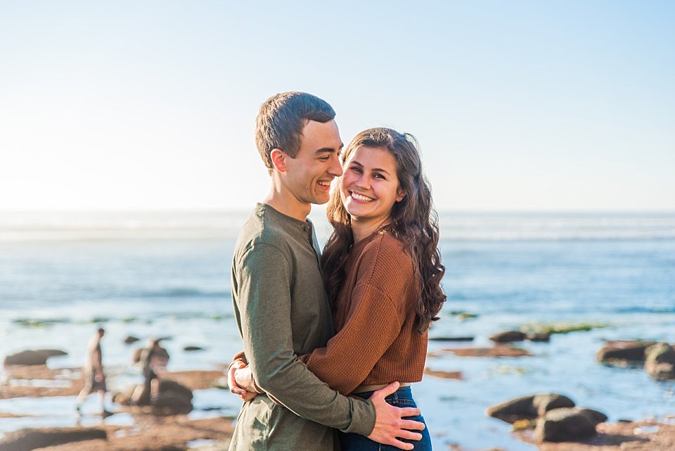 couple playfully laughing sunset cliffs san diego engagement photos